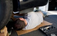 Young Man Fixing Car via Storyblocks